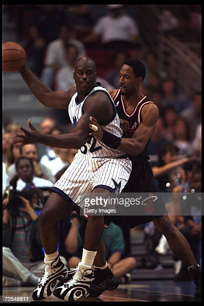 Center Shaquille O'Neal of the Orlando Magic moves against center Alonzo Mourning of the Miami Heat during a game played at the Orlando Arena in...