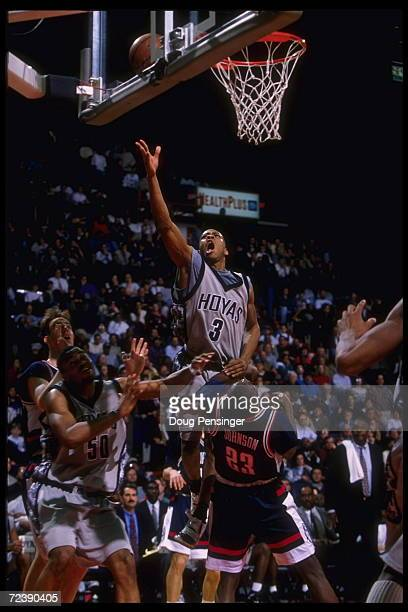 Guard Allen Iverson of the Georgetown Hoyas leaps above all players as he attempts a jump shot against the Connecticut Huskies including forward Rudy...