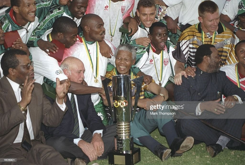 President Nelson Mandela celebrates with the South African players after their victory in the African Nations Cup Final against Tunisia in South...