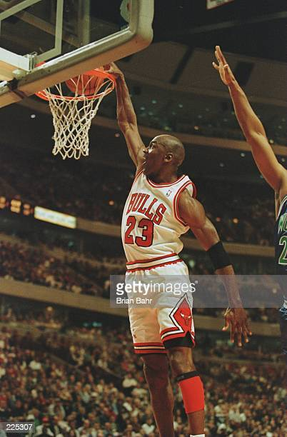 Shooting guard Michael Jordan of the Chicago Bulls focuses on the rim as he is caught in mid air attempting a slam dunk during the Bull's 12099...