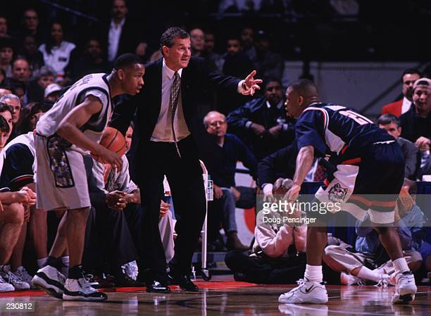 UConn coach Jim Calhoun shouts instructions from the sideline as the Allen Iverson prepares to contest Ricky Moore #21 right of Georgetown as the...