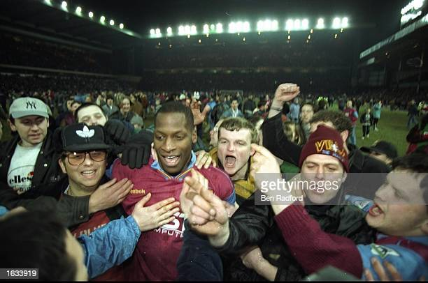 Ugo Ehiogu of Aston Villa is surrounded by fans after the Coca Cola Cup semifinal against Arsenal at Villa Park in Birmingham England The match ended...