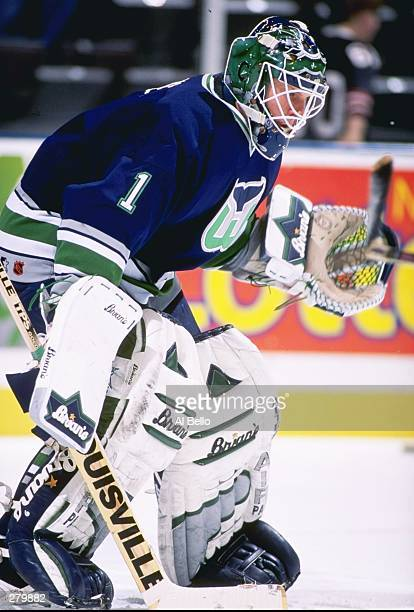 Goaltender Sean Burke of the Hartford Whalers looks on during a game against the New Jersey Devils at the Continental Airlines Arena in East...