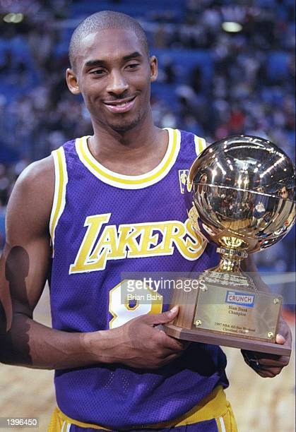 Guard Kobe Bryant of the Los Angeles Lakers holds the Slam Dunk Contest trophy at the Gund Arena in Cleveland Ohio Mandatory Credit Brian Bahr...