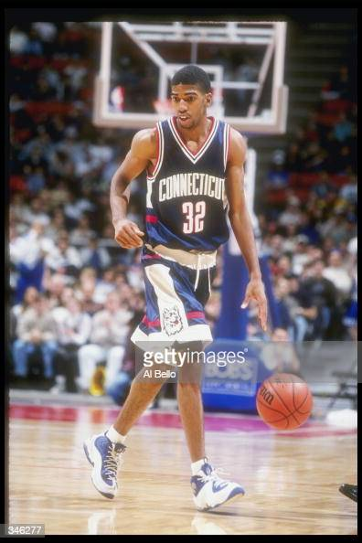 Guard Richard Hamilton of the Connecticut Huskies moves the ball during a game against the Seton Hall Pirates at the Continental Airlines Arena in...