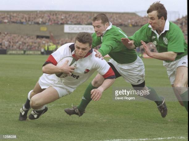 Jon Sleightholme of England with the ball goes over the line to score his country's first try despite efforts from the Irish defence During the Five...