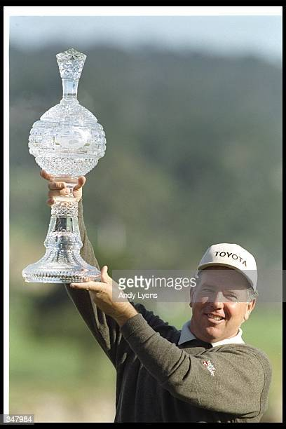 Mark O''Meara poses with a trophy during the ATT National ProAm at the Pebble Beach Golf Course in Pebble Beach California