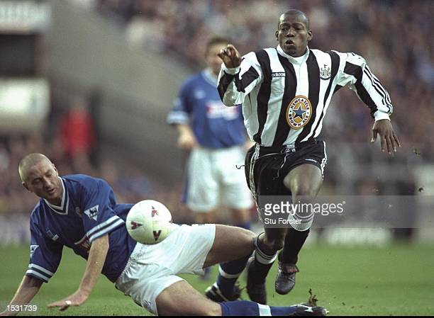 Matt Elliott of Leicester tries to tackle Faustino Asprilla of Newcastle During the FA Carling Premier league match between Newcastle United and...