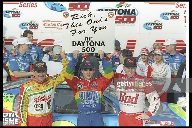 The three drivers of Hendrick Motorsports Jeff Gordon Terry Labonte and Ricky Craven celebrate after finishing 123 in the NASCAR Daytona 500 at...
