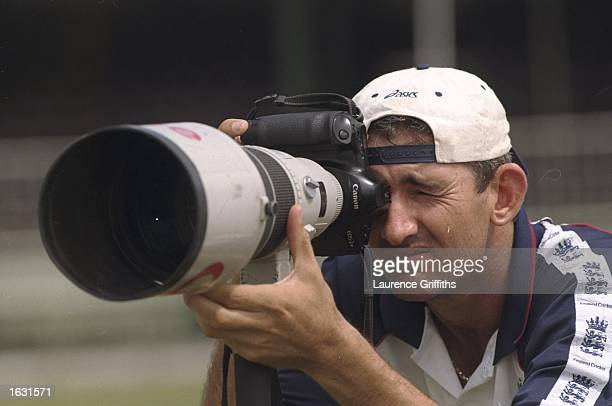 Andy Caddick of England gets behind the lens before the Tour Match against Guyana at Georgetown in Guyana Mandatory Credit Laurence Griffiths...