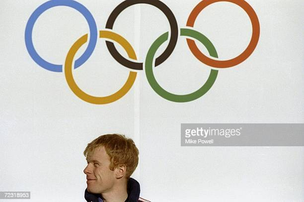 Bjoern Daehlie/Den won Gold Medal fro the 50 klm cross counrty skiing competition stands under the Olympic Rings during the Winter Olympic Games in...