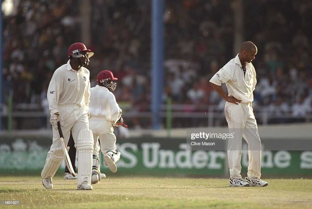Dean Headley of England despairs as Carl Hooper and David Williams edge the West Indies closer to victory during the Second Test at the Queens Park...
