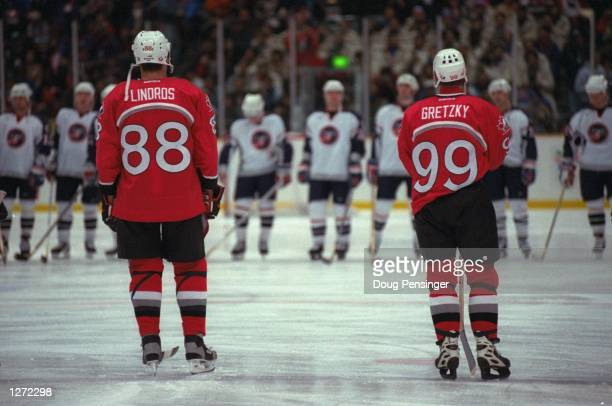 Eric Lindros and Wayne Gretzky face the USA team in the final round game of ice hockey at the Big Hat stadium in the 1998 Olympic Winter Games in...