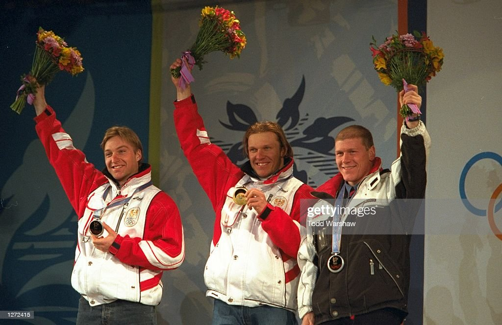 Hermann Maier of Austria wins the gold while Hans Knauss of Austria and Didier Cuche of Switzerland share the silver medal in the mens Super G at...