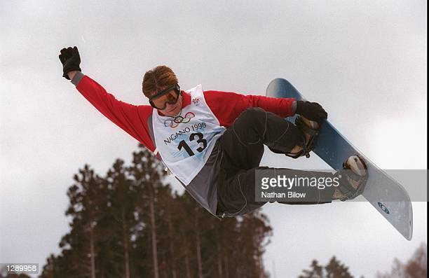 Ross Powers of the United states performs a trick during the halfpipe discipline of the Mens snowboard competition during the 1998 Winter Olympic...