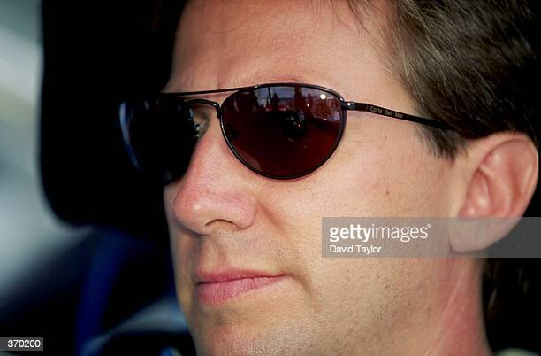 A portrait of John Andretti as he sits in his car during the Daytona 500 Speedweek at the Daytona International Speedway in Daytona Florida