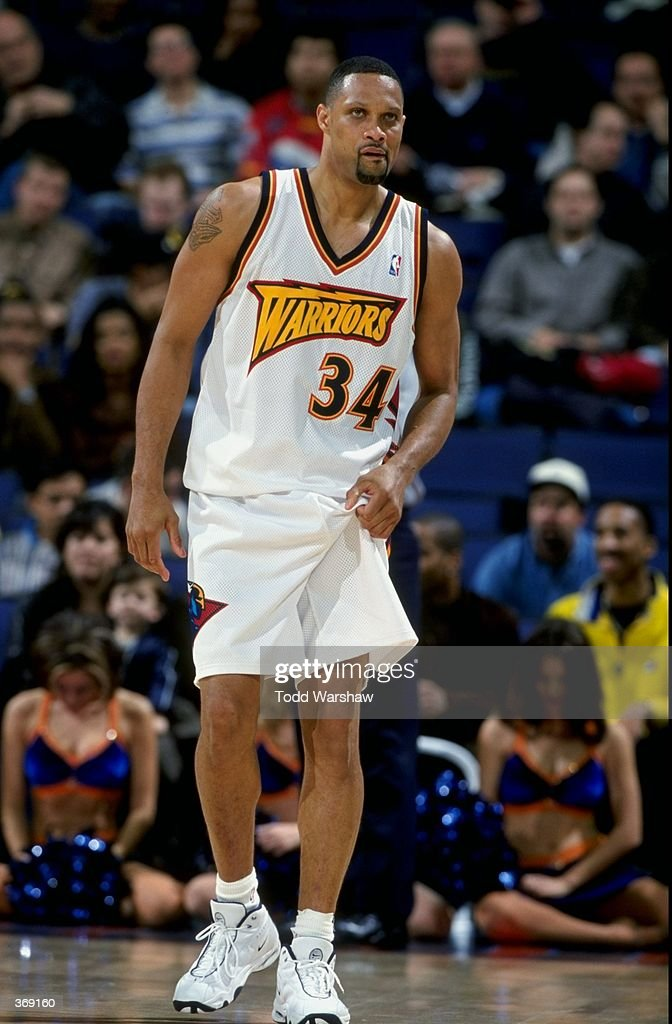 Chris Mills of the Golden State Warriors looks on during the game against the Minnesota Timberwolves at the Oakland Arena in Oakland California The...