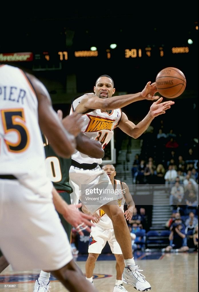 Chris Mills of the Golden State Warriors passes the ball during the game against the Seattle Supersonics at the Oakland Coliseum Arena in Oakland...