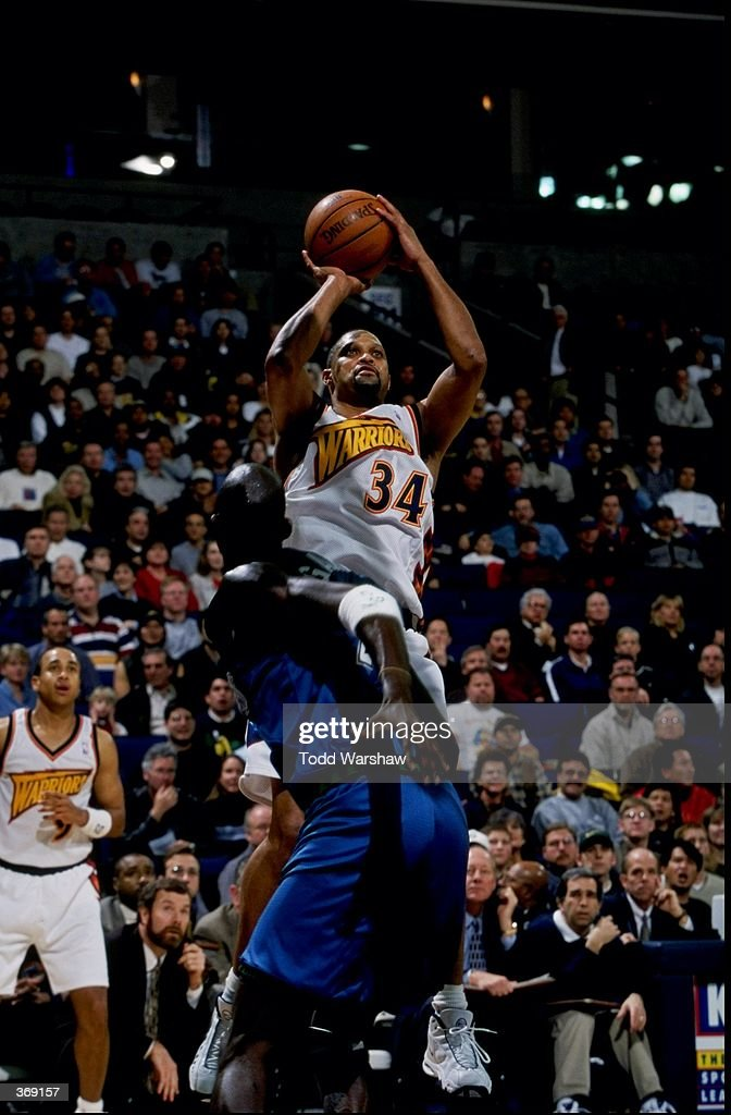 Chris Mills of the Golden State Warriors shooting the ball during the game against the Minnesota Timberwolves at the Oakland Arena in Oakland...