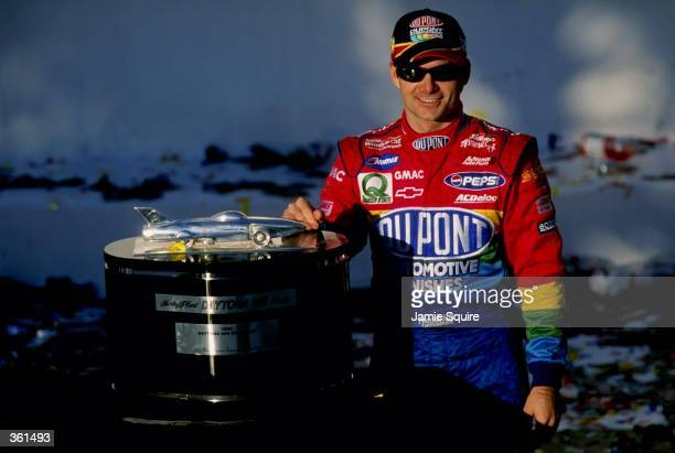 Jeff Gordon poses with the trophy after winning the NASCAR Daytona 500 at the Daytona International Speedway in Daytona Florida Mandatory Credit...
