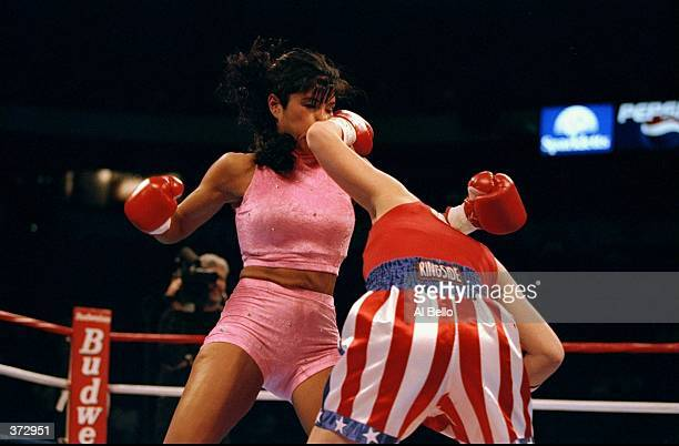 Mia Rosales St John gets hit with a wicked left hook by Amanda Skelton at the Thomas Mack Center in Las Vegas Nevada Mandatory Credit Al Bello...