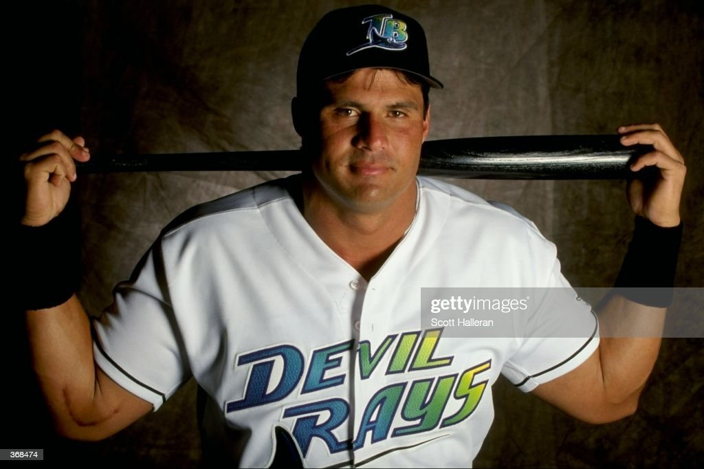 Outfielder Jose Canseco of the Tampa Bay Devil Rays poses for a studio portrait on Photo Day during Spring Training at Lang Stadium in St Petersburg...
