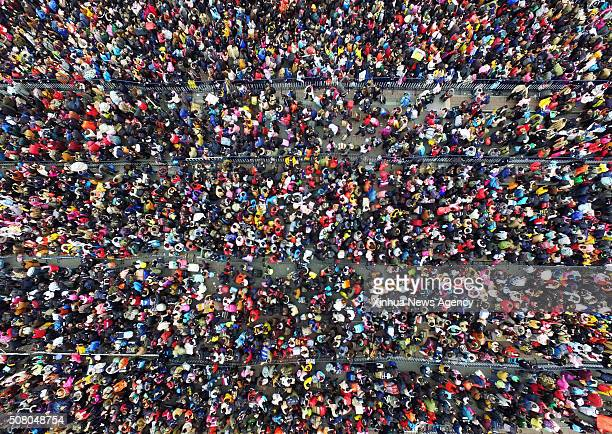 GUANGZHOU Feb 2 2016 Passengers rushing home for the coming Spring Festival or the Chinese Lunar New Year are seen stranded out of Guangzhou railway...