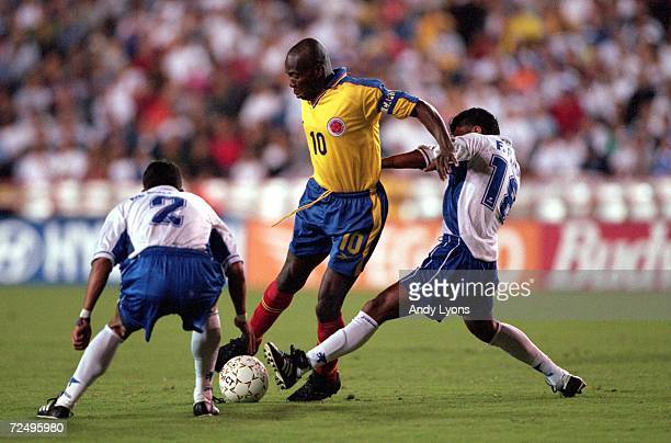 Faustino Hernan Asprilla of Team Columbia moves with the ball as Mario Ivan and Francisco Antonio Pavon of Team Honduras triy to steel it during the...