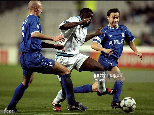 Ibrahim Bakayoko of Olympique De Marseille evades Dennis Wise and Frank Leboeuf of Chelsea during the European Champions League game played in the...