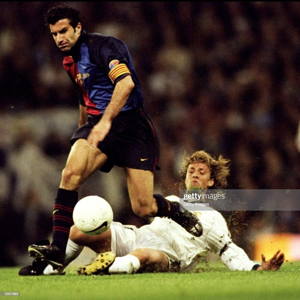 Luis Figo of Barcelona leaves Guti of Real Madrid in his wake