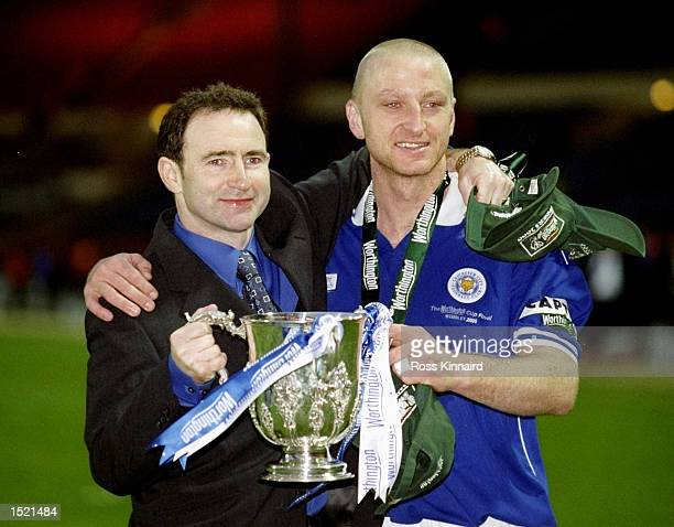 Martin ONeill and Matt Elliott of Leicester City hold the cup in celebration after the Worthington Cup Final victory over Tranmere Rovers played at...