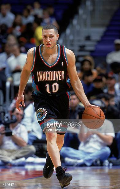 Mike Bibby of the Vancouver Grizzlies moves with the ball during the game against the Los Angeles Clippers at Staples Center in Los Angeles...