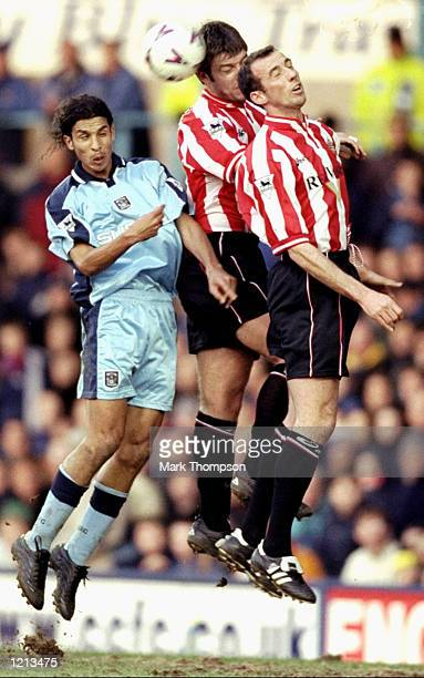 Paul Butler of Sunderland rises above team mate Eric Roy and Youssef Chippo of Coventry City during the FA Carling Premiership match at Highfield...