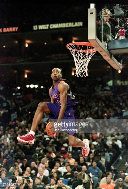 Vince Carter of the Toronto Raptors jumps during the NBA Allstar Game Slam Dunk Contest at the Oakland Coliseum in Oakland California Mandatory...