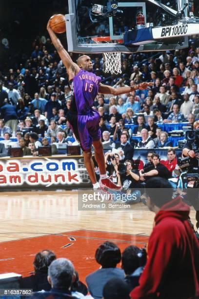 Vince Carter of the Toronto Raptors jumps during the NBA AllStar Slam Dunk Contest at the Oakland Coliseum in Oakland California circa 2000 NOTE TO...