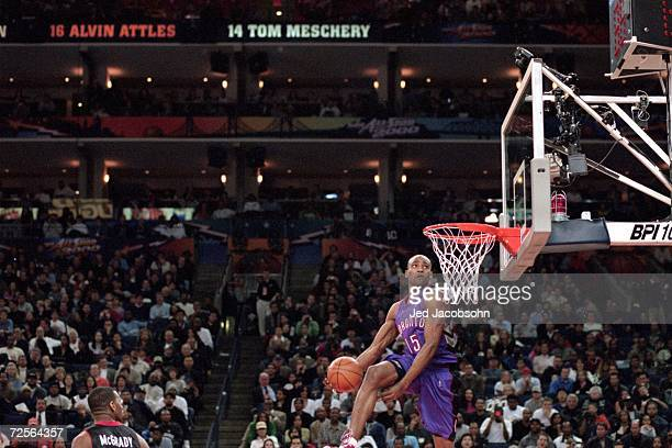 Vince Carter of the Toronto Raptors jumps to dunk the ball during the NBA All Star Weekend Slam Dunk Contest at the Oakland Coliseum in Oakland...
