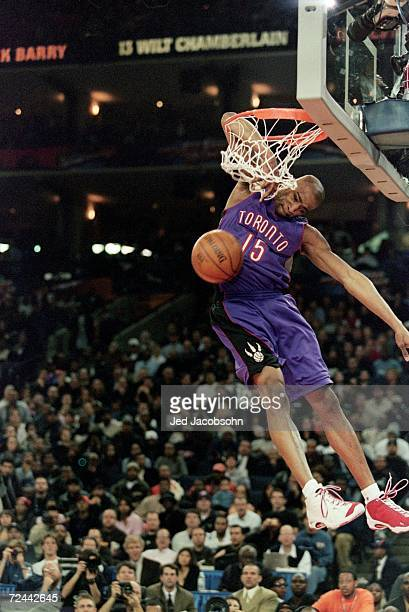 Vince Carter of the Toronto Raptors jumps to make the slam dunk during the NBA Allstar Game Slam Dunk Contest at the Oakland Coliseum in Oakland...