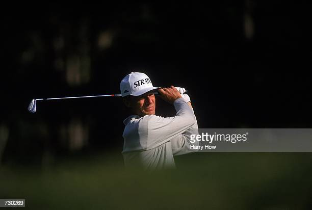 A close up of Bernhard Langer of Germany as he watches the ball after hitting it during the ATT Pebble Beach ProAM at the Poppyhills Golf Course in...