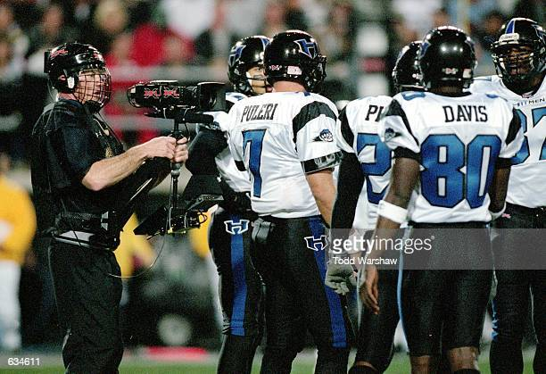 A view of the XFL camera man as he films the huddle taken during the game between the Las Vegas Outlaws and the New York/New Jersey Hitmen at the Sam...