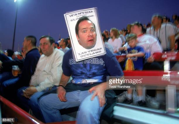 A view of the XFl fan as he wears a wanted poster on his head taken during the game between the Las Vegas Outlaws and the New York/New Jersey Hitmen...