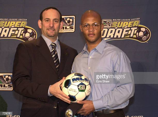 Ali Curtis the second pick overall during the Major League Soccer Super Draft by the Tampa Bay Mutiny poses for a picture with MLS commissioner Don...