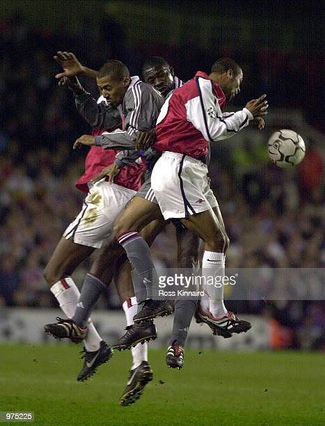 Ashley Cole of Arsenal Sidney Govou and MarcVivien of Olympique Lyonnais in action during the UEFA Champions League match between Arsenal and...