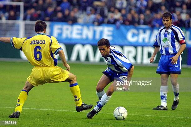 Carlos Sandro of Malaga and Jose Josico of Las Palmas in action duing the Primera Liga match between Malaga and Las Palmas Spain DIGITAL IMAGE X...