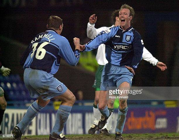 Dave Carrol of Wycombe celebrates with Andy Rammell after scoring during the AXA sponsored FA Cup 5th round replay match between Wimbledon and...