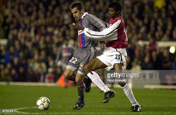 David Linares of Lyon holds off Kanu of Arsenal during the Champions League match between Arsenal and Lyon at Highbury London England Digital Image...