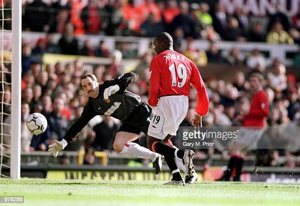 Dwight Yorke of Man Utd scores the first goal of the match during the FA Carling Premiership match between Manchester United and Arsenal played at...