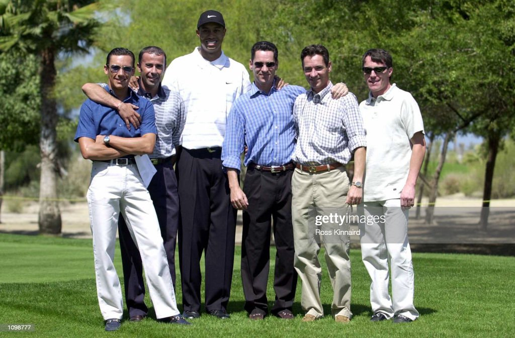 Jockeys Frankie Dettori, John Carroll, Michael Hills, Richard Hills and Kieron Fallon pictured with Tiger Woods during his first practice round at the Emirates Golf Club ahead of the Dubai Desert Classic in Dubai. Digital Image. MandatoryCredit: Ross Kinnaird/ALLSPORT