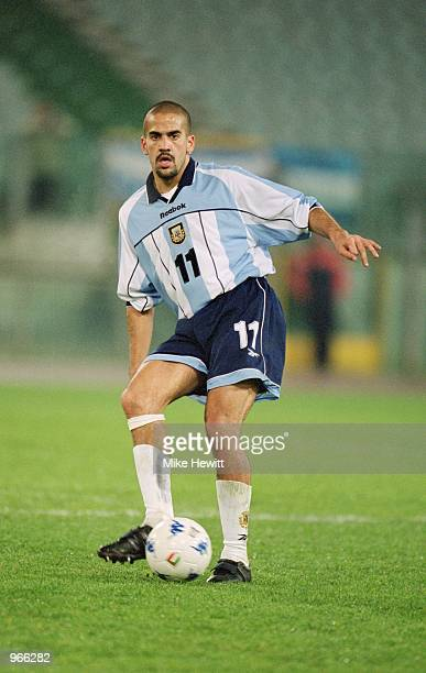 Juan Sebastian Veron of Argentina passes the ball during the International Friendly match against Italy played at the Stadio Olimpico in Rome Italy...