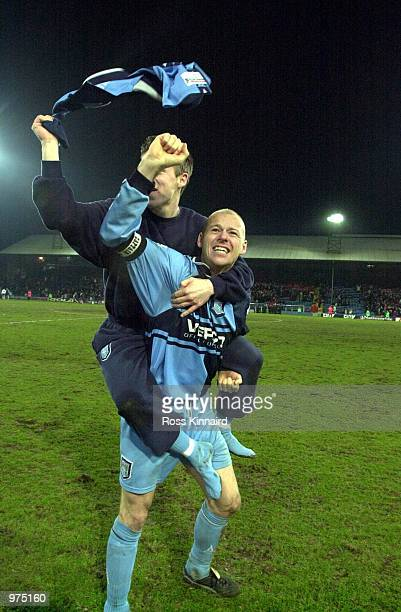 Keith Ryan of Wycombe Wanderers celebrates after his team's win in the AXA sponsored FA Cup 5th round replay match between Wimbledon and Wycombe...