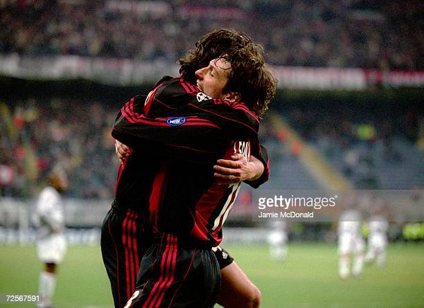 Leonardo celebrates opening the scoring with teammate Demetrio Albertini of AC Milan during the UEFA Champions League Group B match against Paris St...